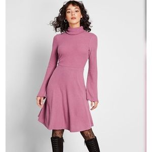 Pink turtleneck sweater dress with bell sleeves